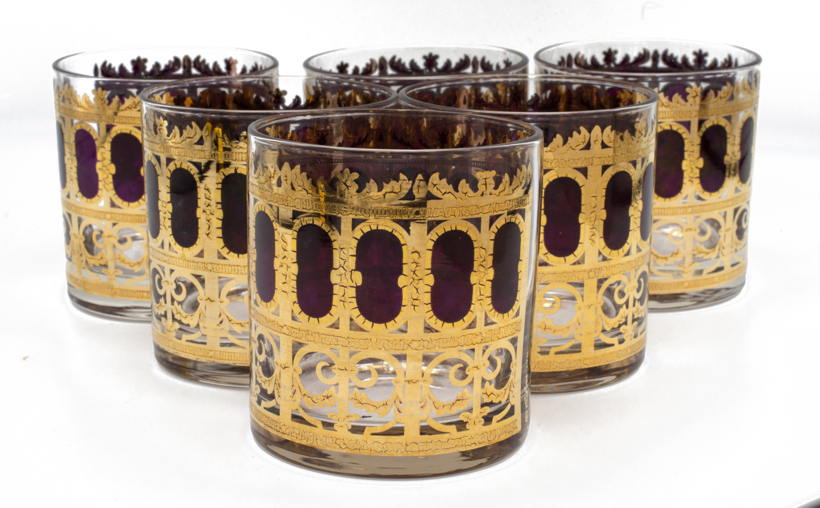 """Set of 6(six) Culver """"Cranberry Scrol"""" pattern with 22k gold embellishments rocks glasses."""